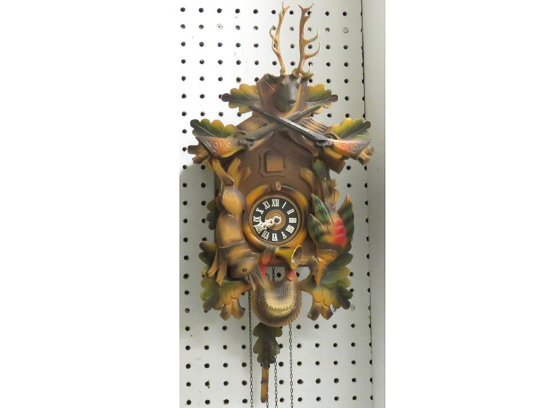 GERMAN BLACK FOREST CARVED CUCKOO CLOCK. HEIGHT 17""