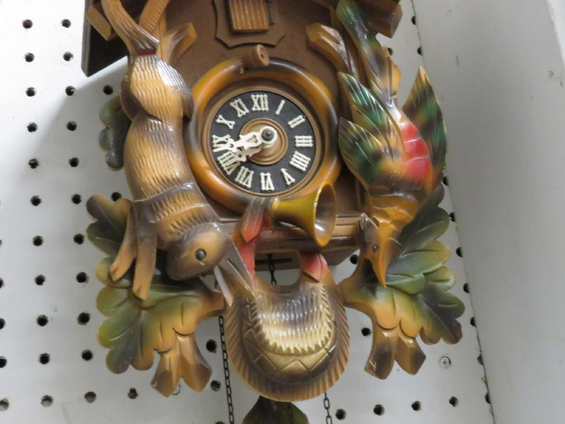 "GERMAN BLACK FOREST CARVED CUCKOO CLOCK. HEIGHT 17"" - 2"