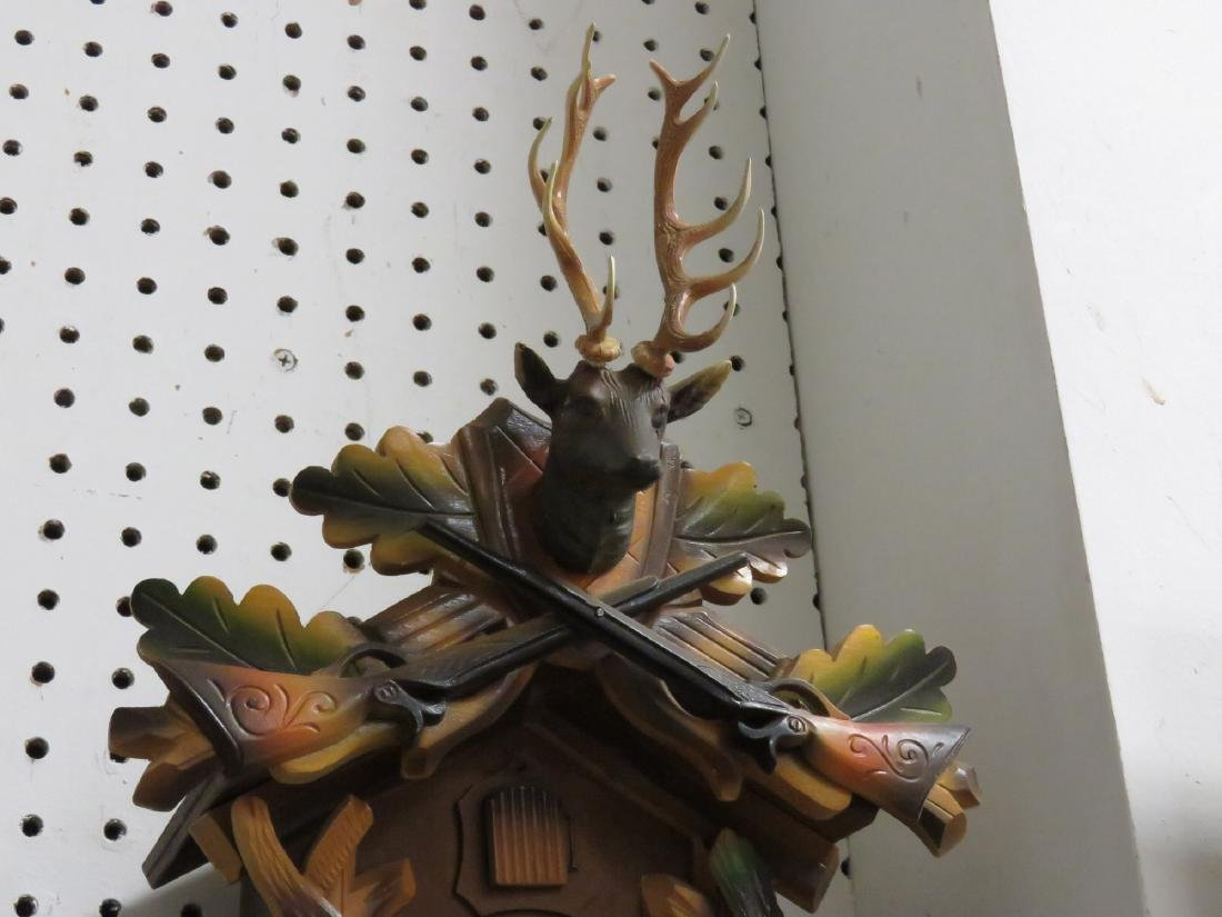 "GERMAN BLACK FOREST CARVED CUCKOO CLOCK. HEIGHT 17"" - 3"