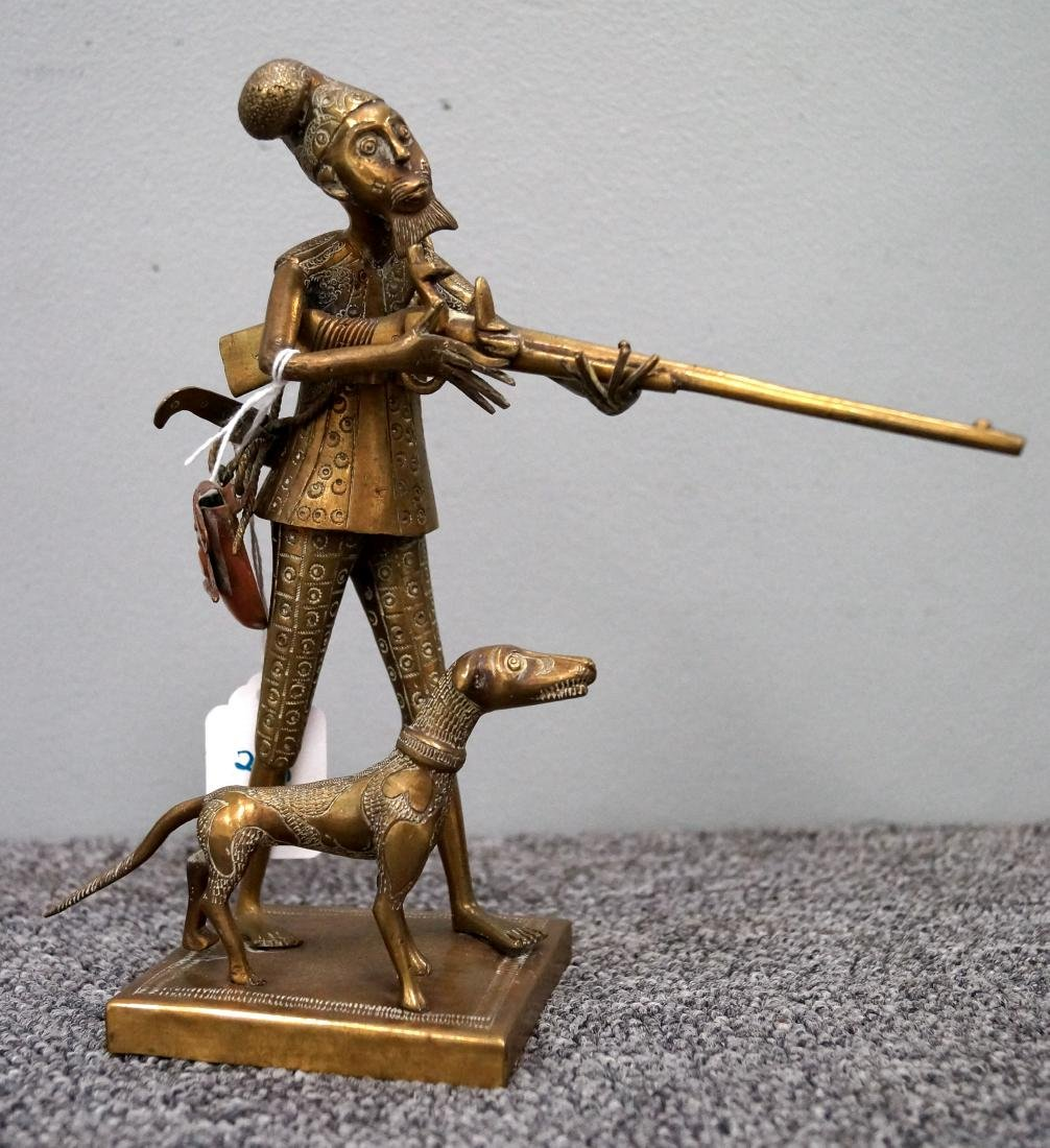 CAUCASIAN BRASS AND COPPER FIGURE OF A HUNTER/DOG.