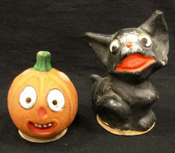 1021: VINTAGE HALLOWEEN COMPOSITION CANDY CONTAINERS