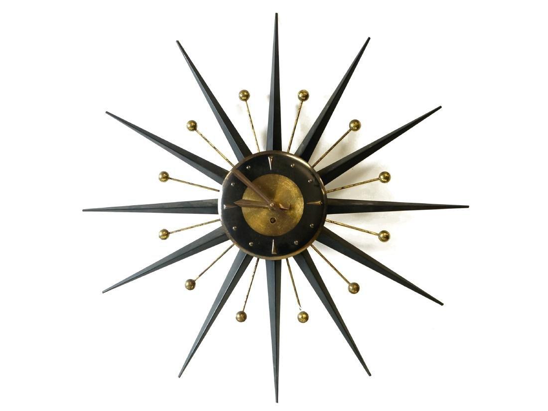 "MID-CENTURY METAL STARBURST CLOCK. DIAMETER 25"""
