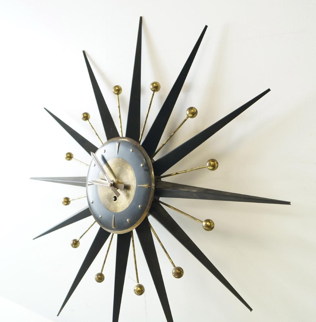 "MID-CENTURY METAL STARBURST CLOCK. DIAMETER 25"" - 2"