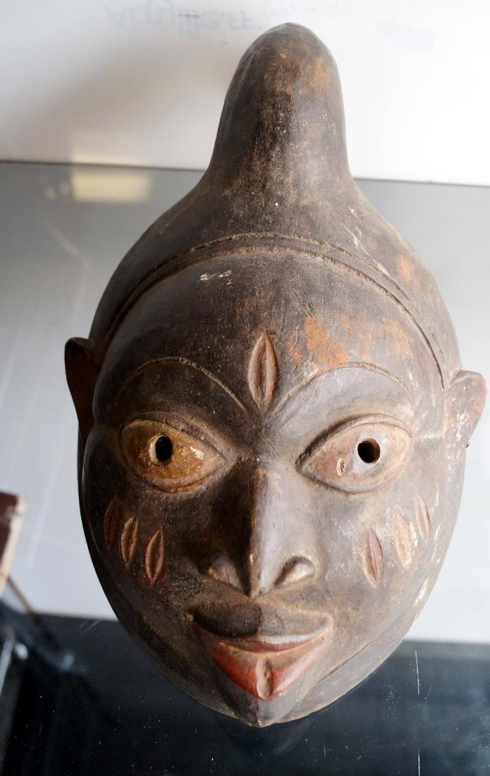 YORUBA, NIGERIA, CARVED HORNED ROYALTY MASK. HEIGHT 14""