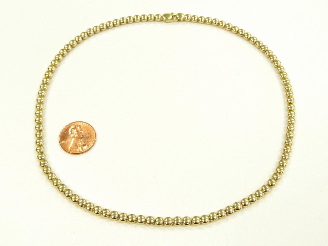 "ITALIAN 18K YELLOW GOLD BEADED NECKLACE. LENGTH 16 1/2"";"