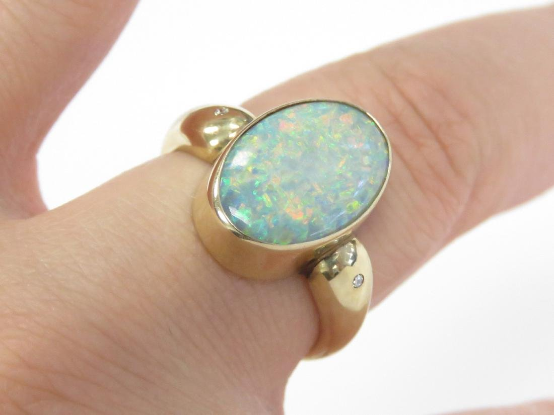 585 YELLOW GOLD AND OPAL RING. RING SIZE 8; GROSS