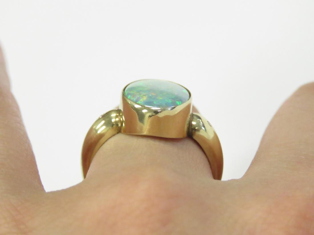 585 YELLOW GOLD AND OPAL RING. RING SIZE 8; GROSS - 2