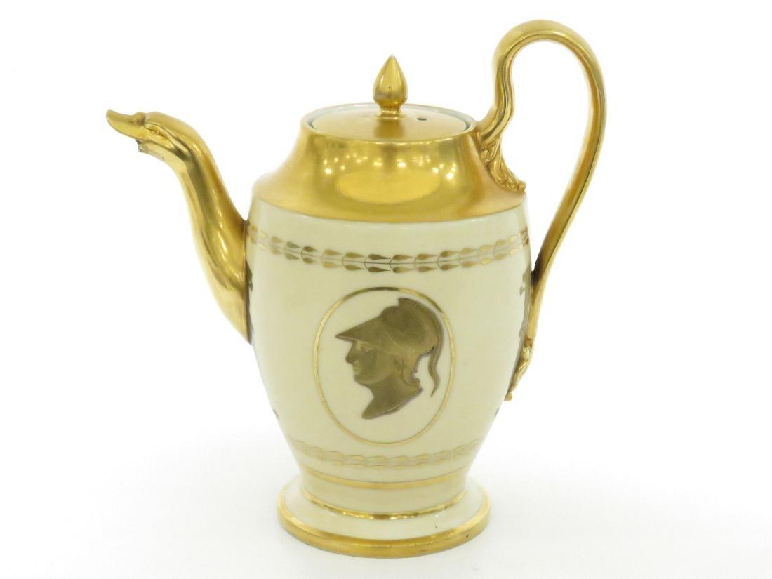 BIEDERMEIER GILT PORCELAIN COFFEE POT, 19TH CENTURY.