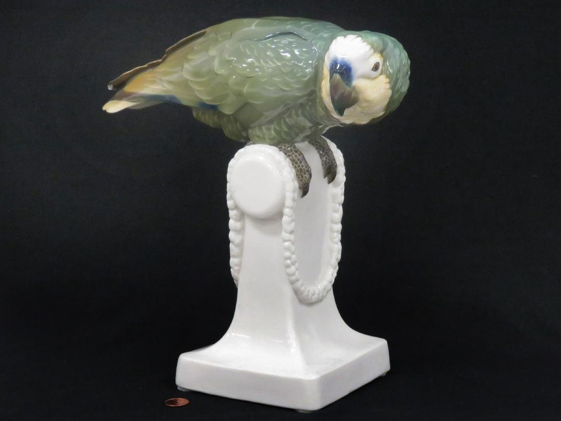 NYMPHENBURG PORCELAIN DECORATED GREEN PARROT. HEIGHT