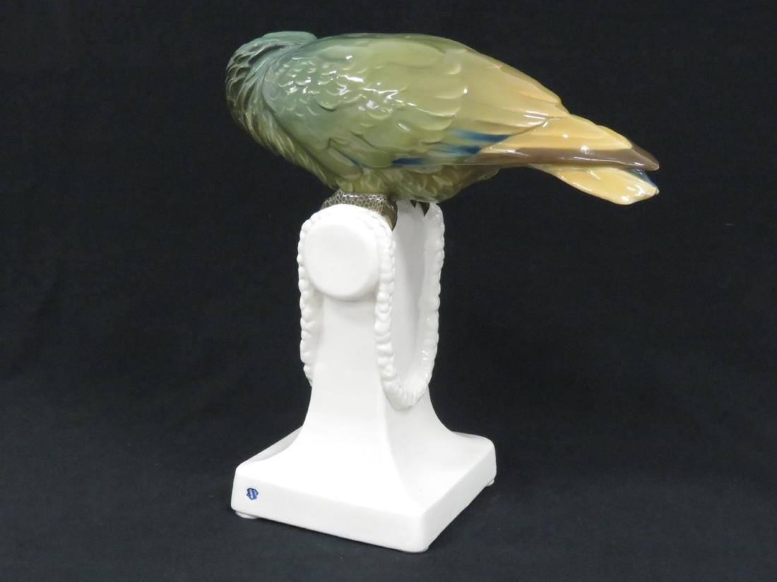NYMPHENBURG PORCELAIN DECORATED GREEN PARROT. HEIGHT - 2