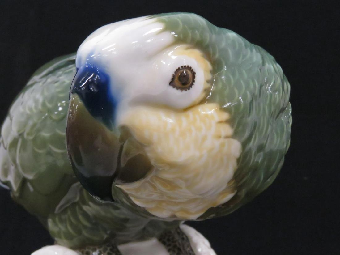 NYMPHENBURG PORCELAIN DECORATED GREEN PARROT. HEIGHT - 5