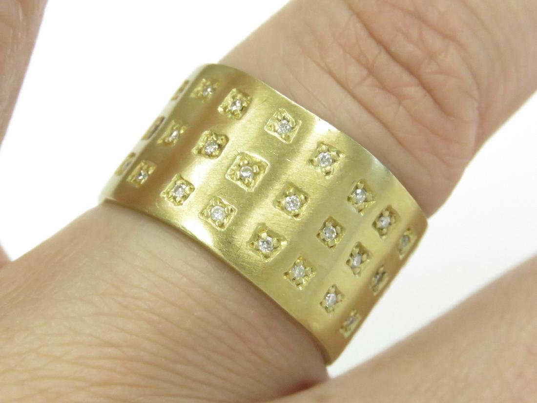 750 BURNISHED YELLOW GOLD BAND SET WITH (42) 1.0MM