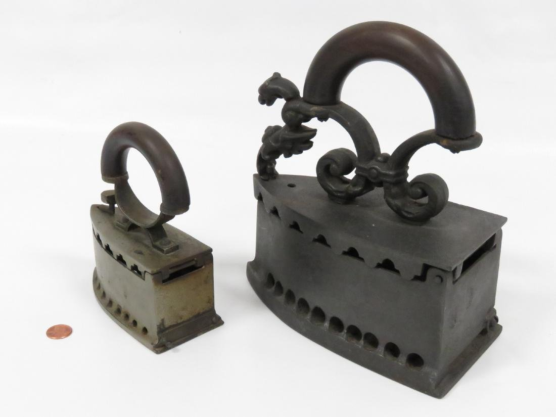 """LOT (2) ANTIQUE CHARCOAL IRONS. LENGTH 5 3/8-8"""" - 2"""