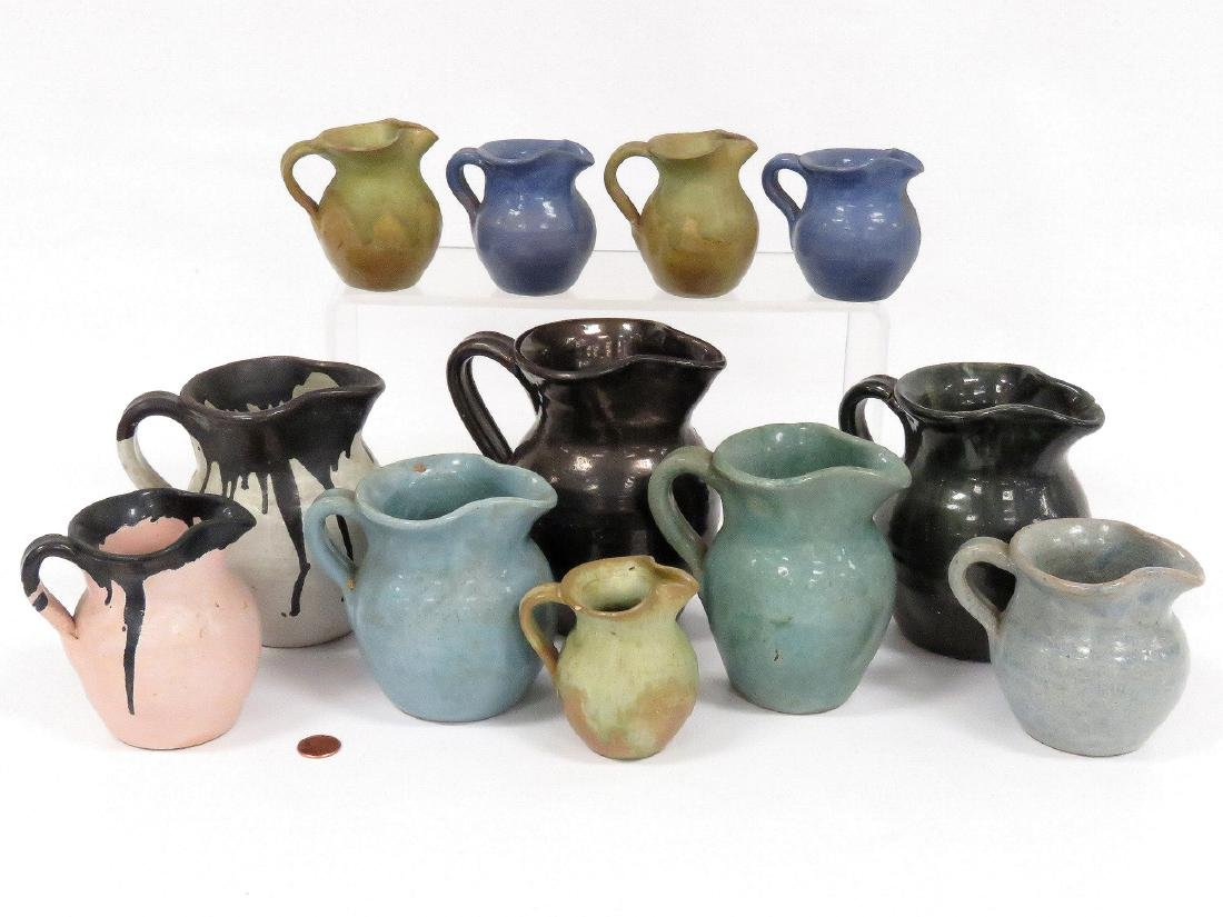 LOT (12) ASSORTED JUG TOWN POTTERY PITCHERS, SIGNED.