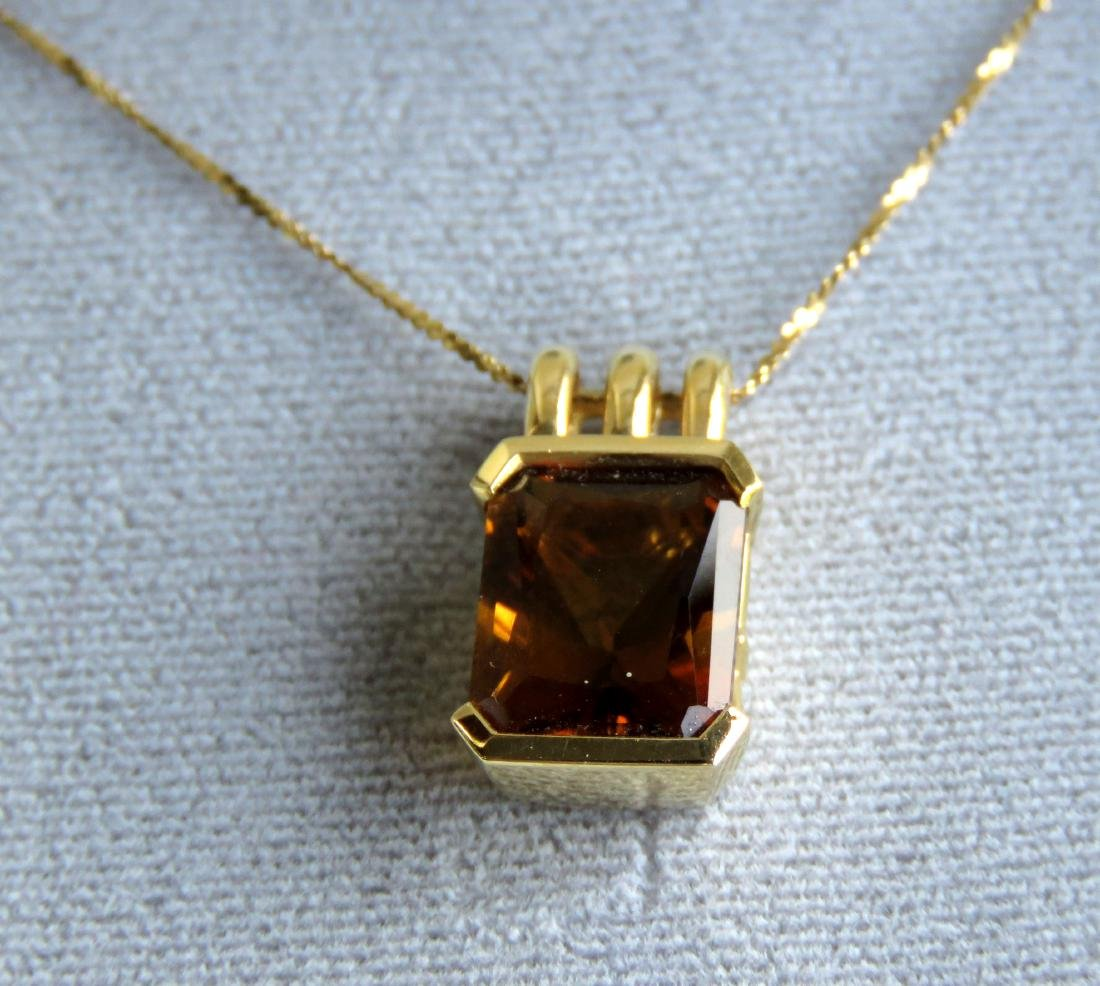 14K YELLOW GOLD AND CITRINE PENDANT WITH CHAIN.