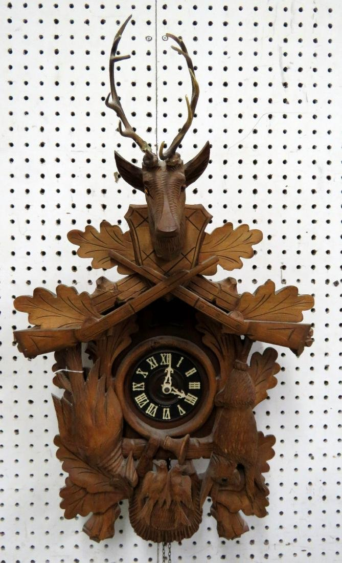 """BLACK FOREST CARVED WALNUT CUCKOO CLOCK. HEIGHT 26"""""""