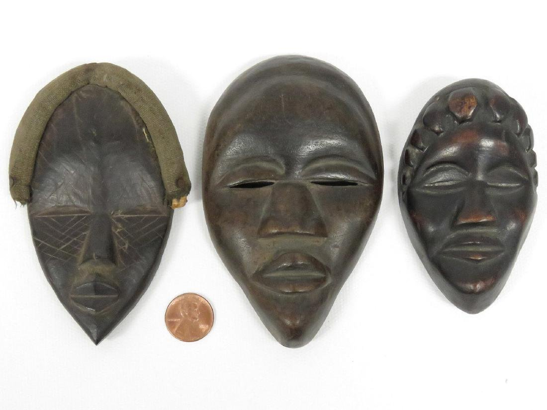 LOT (3) DAN, IVORY COAST, CARVED PASSPORT MASKS. HEIGHT