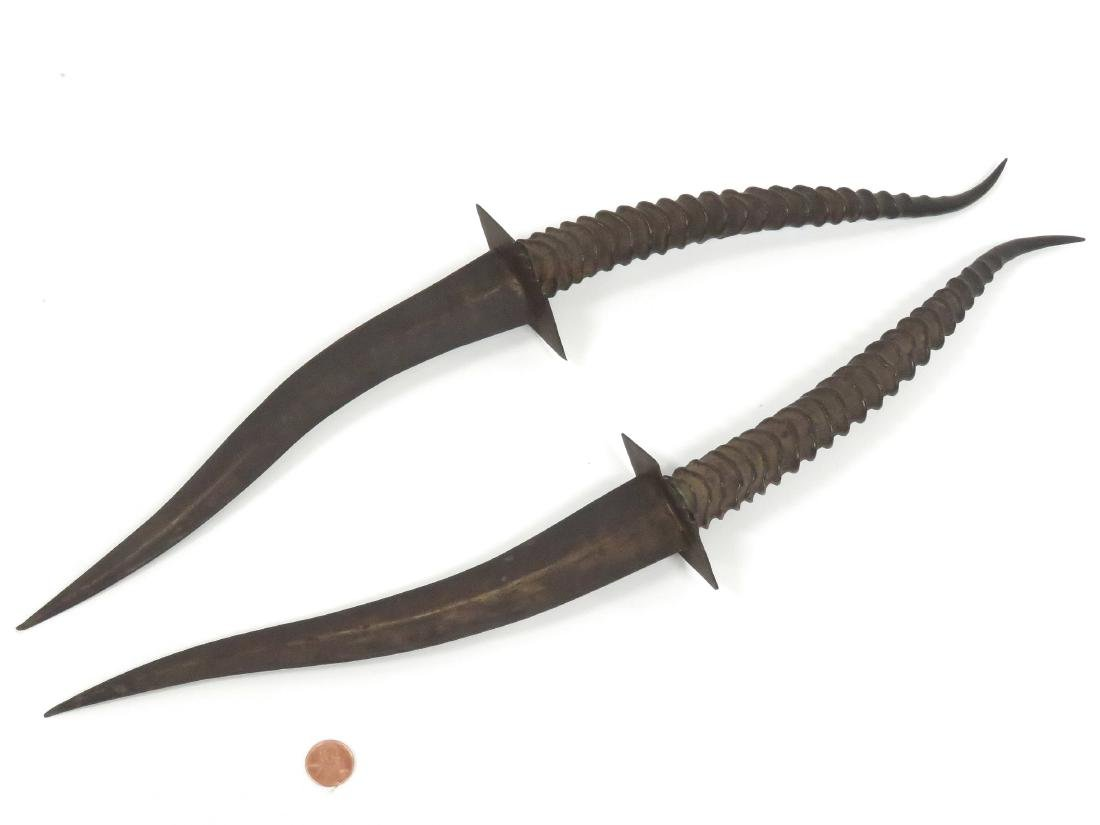 PAIR ETHIOPIAN ANTELOPE HORN HANDLED DAGGERS. LENGTH