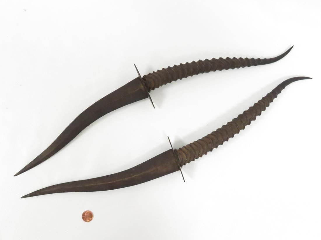 PAIR ETHIOPIAN ANTELOPE HORN HANDLED DAGGERS. LENGTH - 2