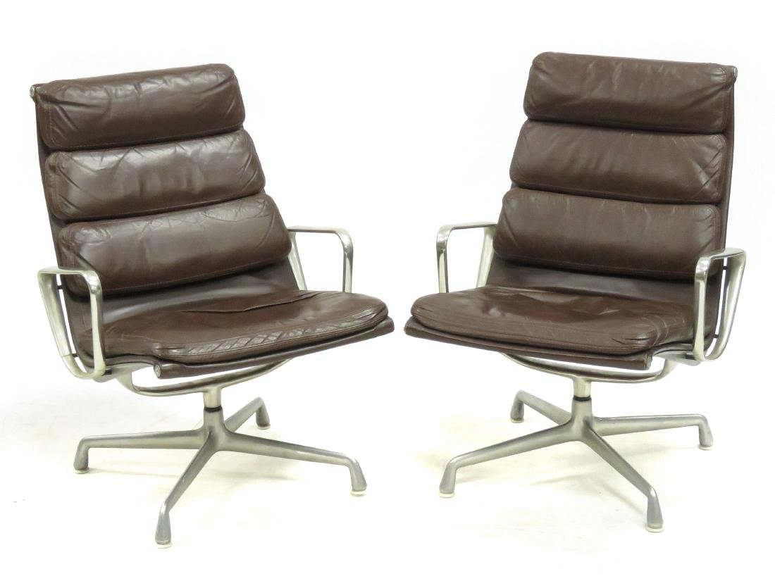 PAIR CHARLES AND RAY EAMES LEATHER SOFA PAD ARMCHAIRS