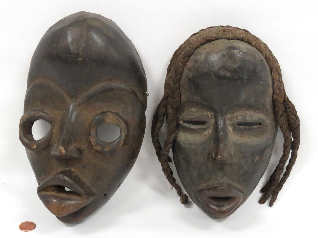 LOT (2) DAN, IVORY COAST, CARVED WOOD MASKS. HEIGHT 8