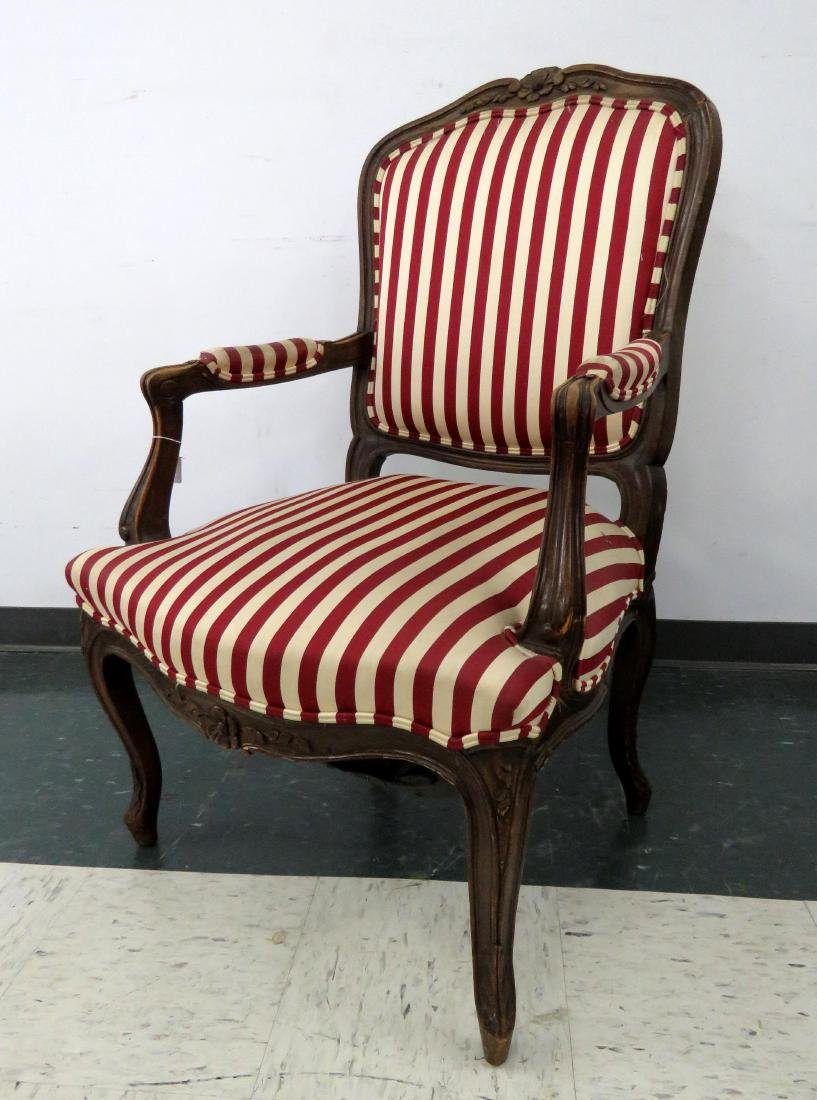 FRENCH STYLE CARVED FRUITWOOD ARMCHAIR
