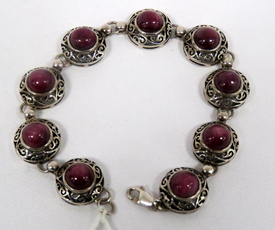 925 STERLING AND RUBY RETICULATED FRAME LINE BRACELET.