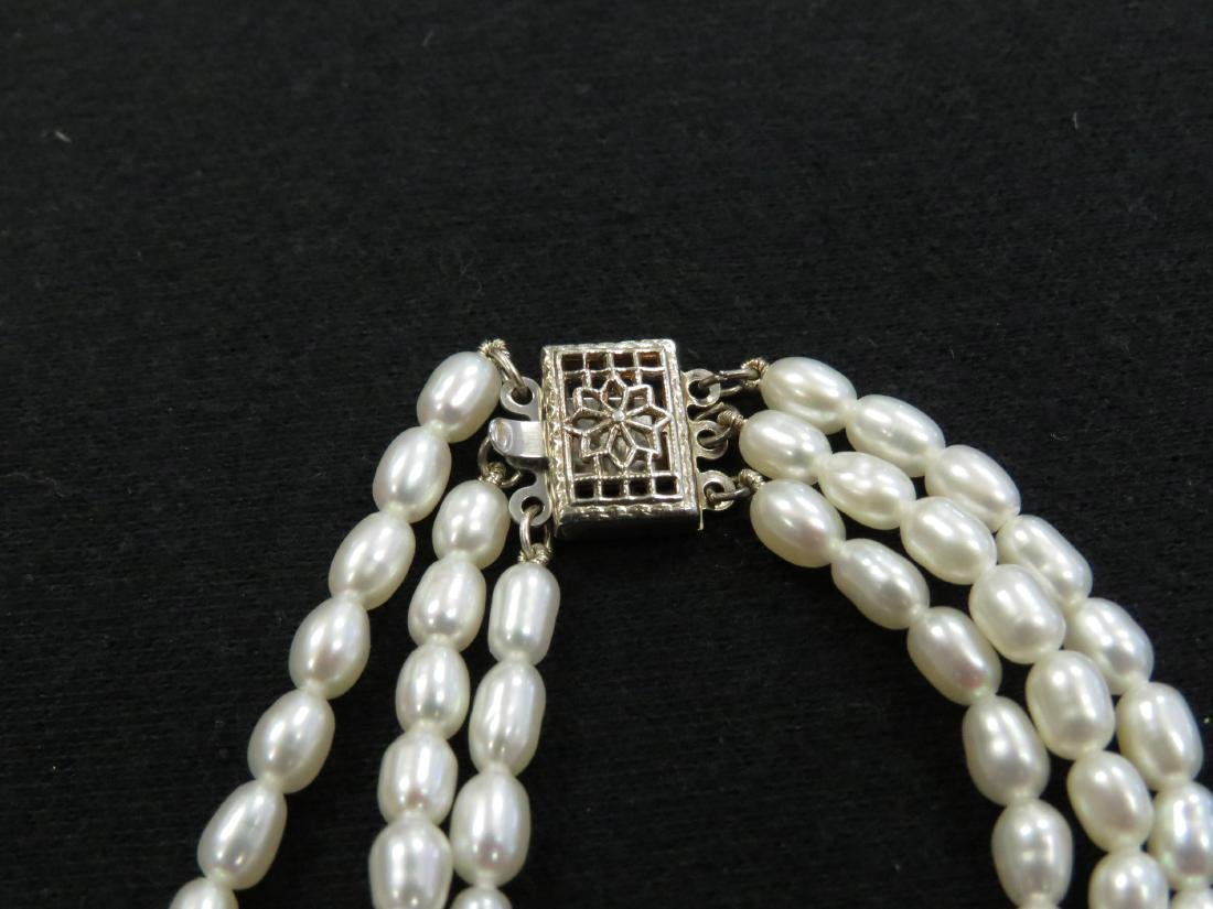 """3-STRAND FRESHWATER PEARL NECKLACE. LENGTH 16 1/2"""" - 2"""