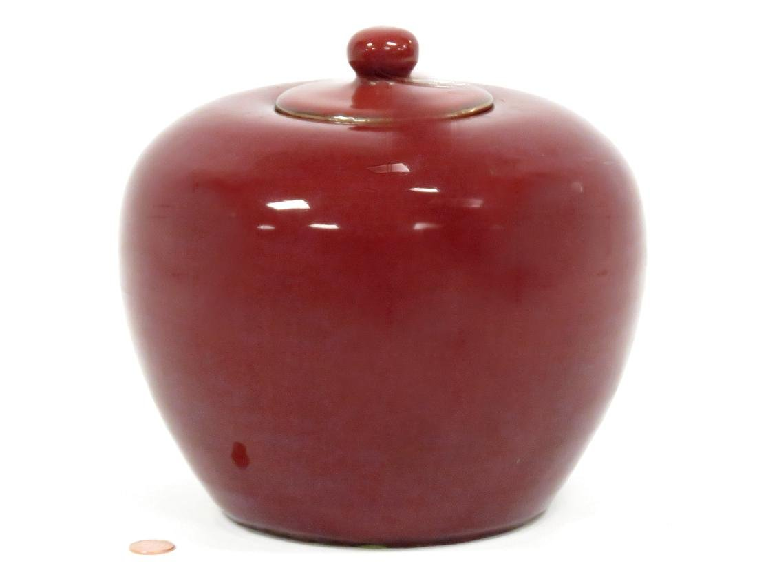 CHINESE SANG DE BOUEUF GLAZED COVERED JAR. HEIGHT 8