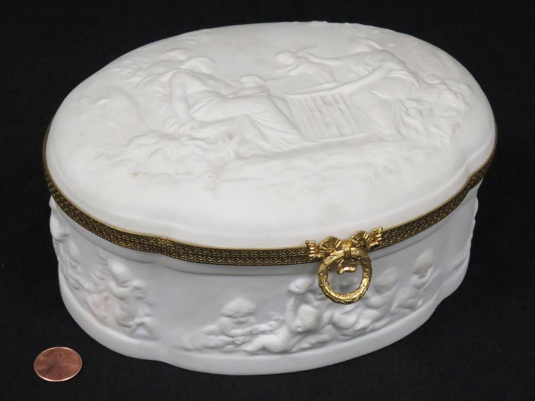 LIMOGES BISQUE PORCELAIN AND GILT METAL MOUNTED DRESSER