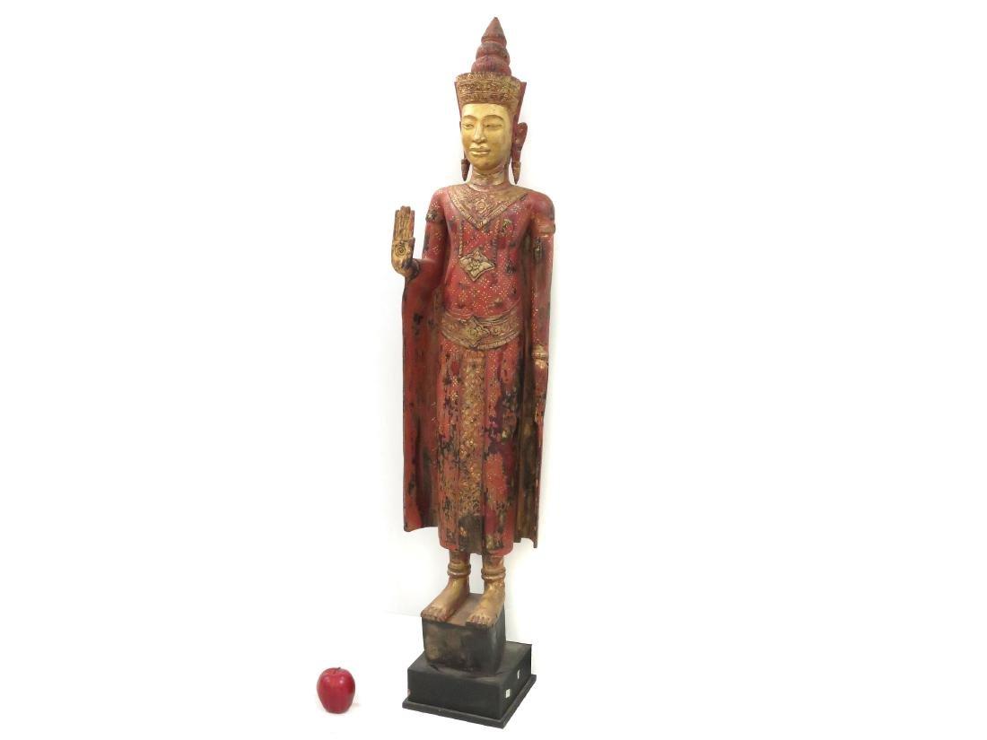 THAI CARVED, PAINTED AND GILT WOOD BUDDHA ABHAYA MUDRA