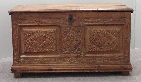12: CONTINENTAL CARVED PINE PANELED CHEST