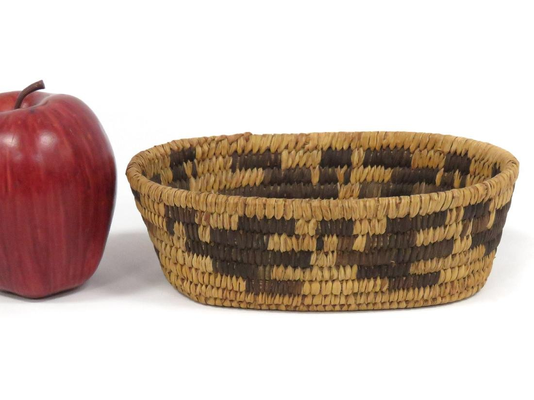 "SW NATIVE AMERICAN WOVEN BASKET. HEIGHT 2 1/4""; 4 1/2 X"