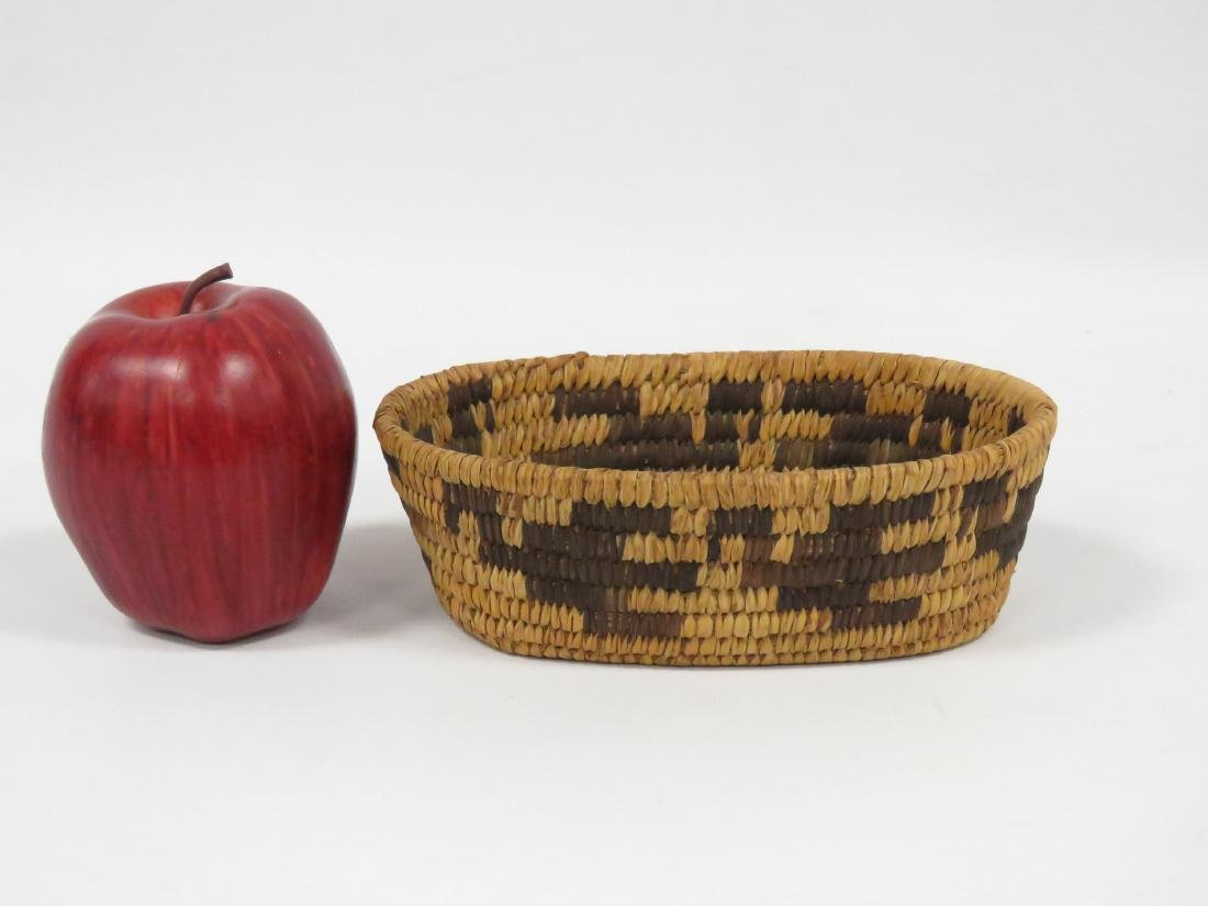 "SW NATIVE AMERICAN WOVEN BASKET. HEIGHT 2 1/4""; 4 1/2 X - 2"