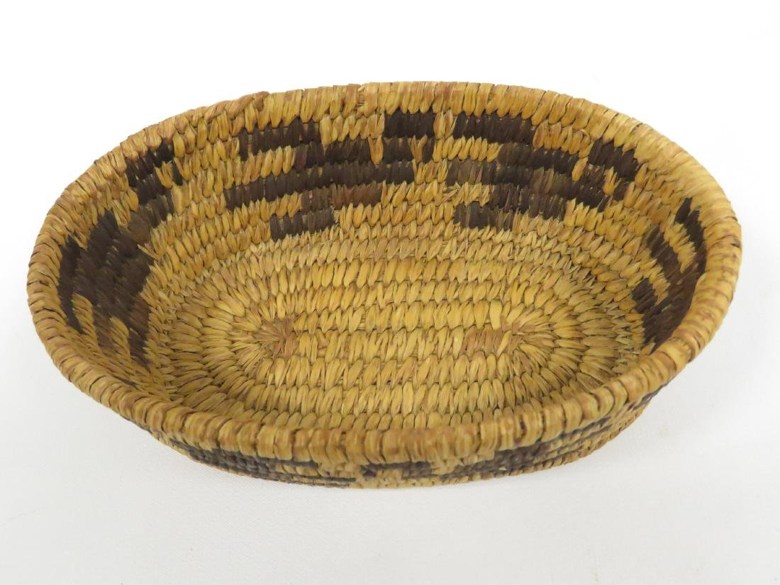 "SW NATIVE AMERICAN WOVEN BASKET. HEIGHT 2 1/4""; 4 1/2 X - 3"