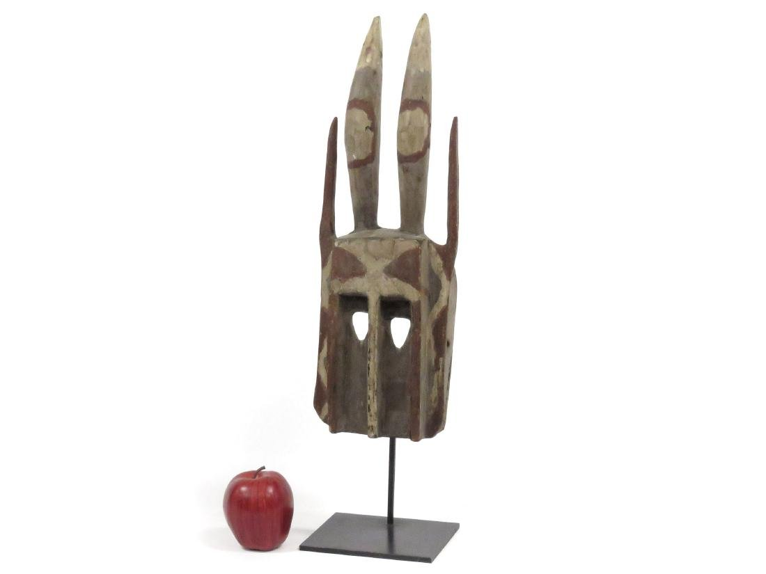 DOGON, MALI, CARVED AND PAINTED HORNED MASK. HEIGHT 18
