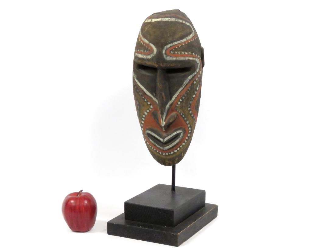 NEW GUINEA, CARVED AND PAINTED ANCESTOR MASK.