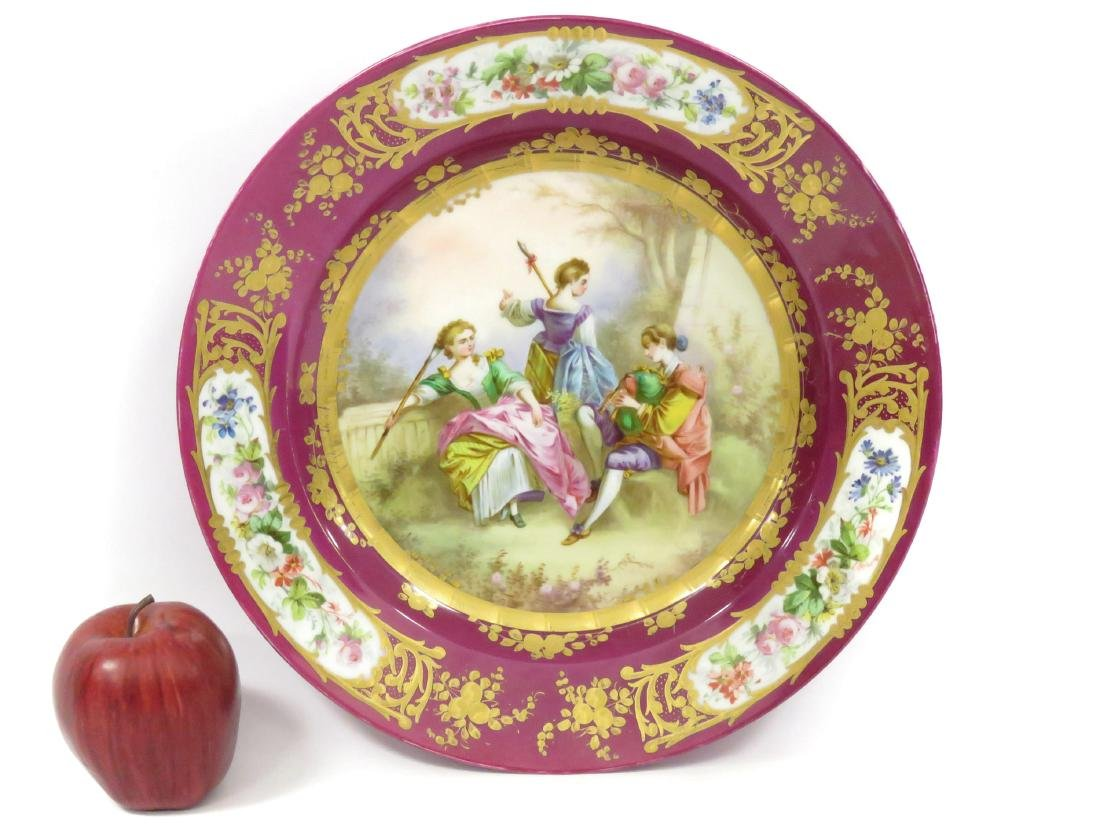SEVRES DECORATED PORCELAIN CHARGER, SIGNED. DIAMETER