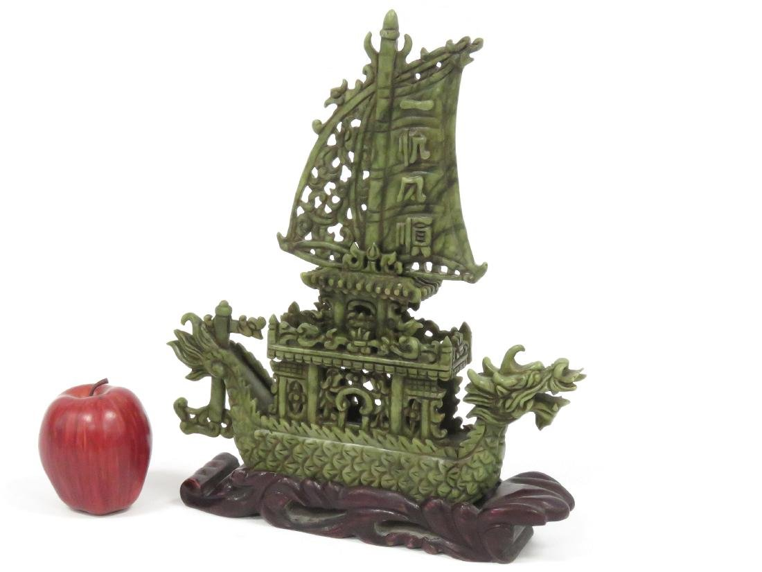 CHINESE CARVED GREEN HARDSTONE DRAGON BOAT ON STAND.