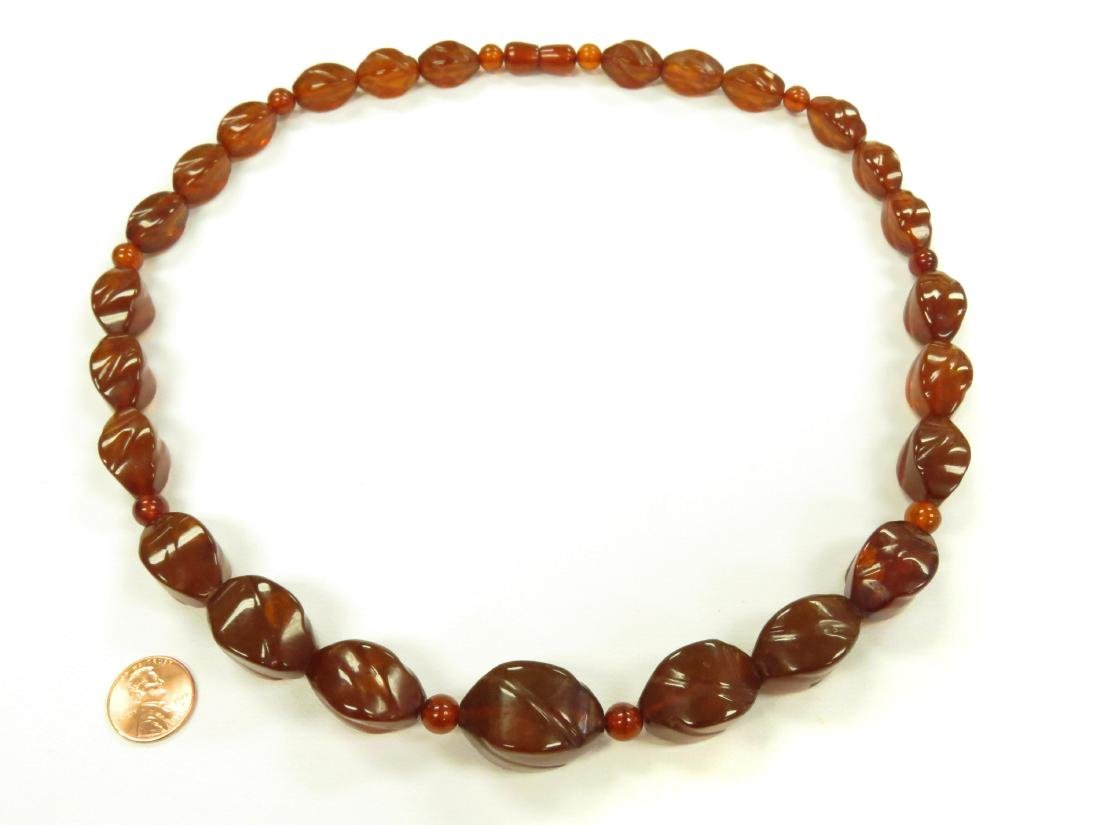 VINTAGE STRAND CARVED AND SHAPED AMBER BEADED NECKLACE