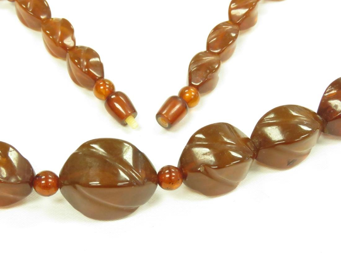 VINTAGE STRAND CARVED AND SHAPED AMBER BEADED NECKLACE - 2