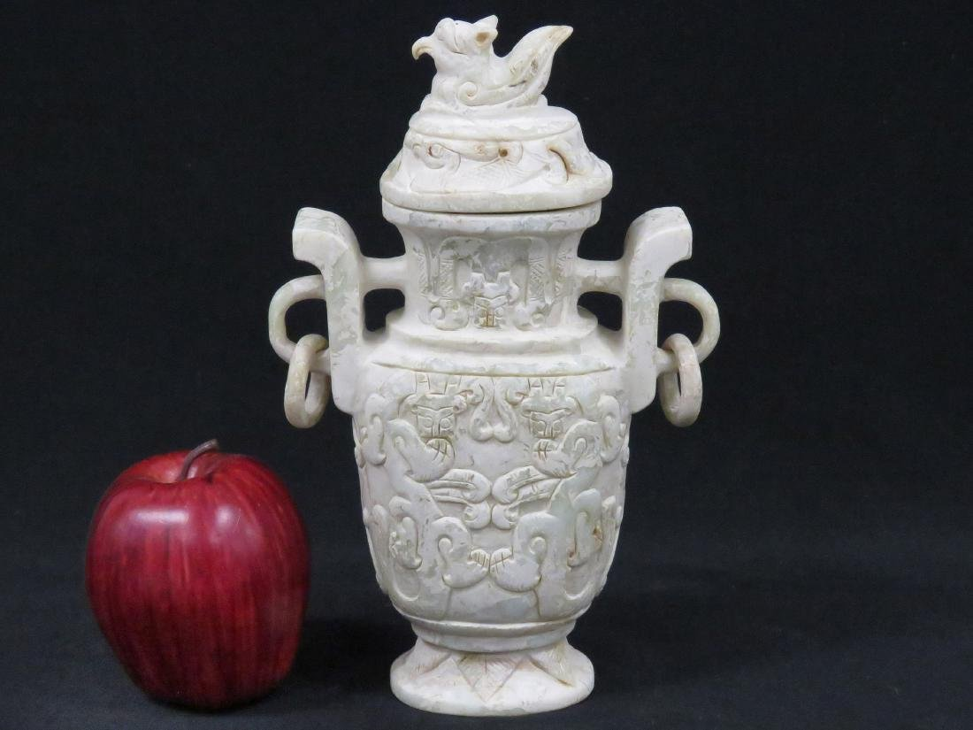 CHINESE CARVED HARDSTONE ARCHAIC-FORM COVERED VASE.