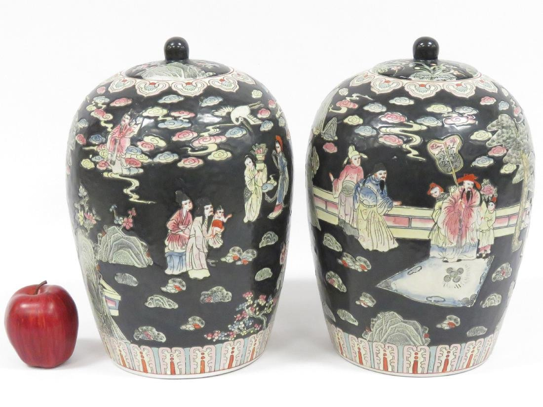 PAIR CHINESE FAMILLE NOIRE DECORATED PORCELAIN COVERED
