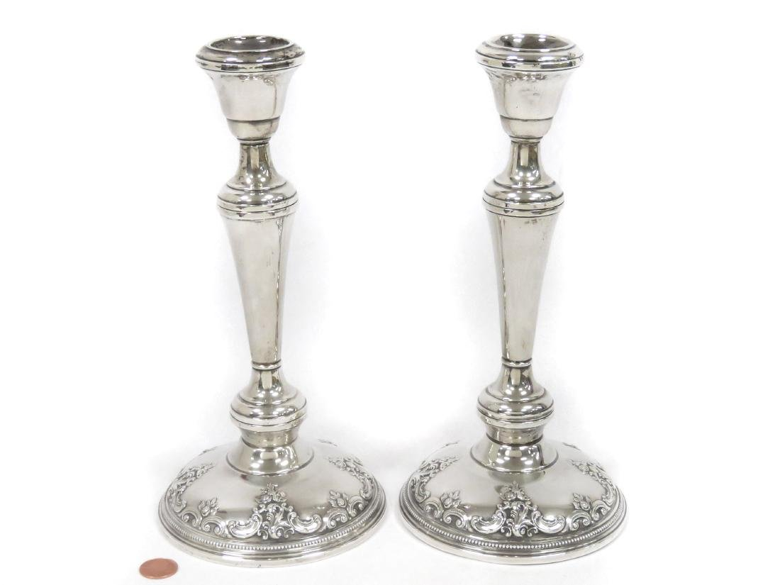 PAIR STERLING SILVER WEIGHTED CANDLESTICKS. HEIGHT 10""