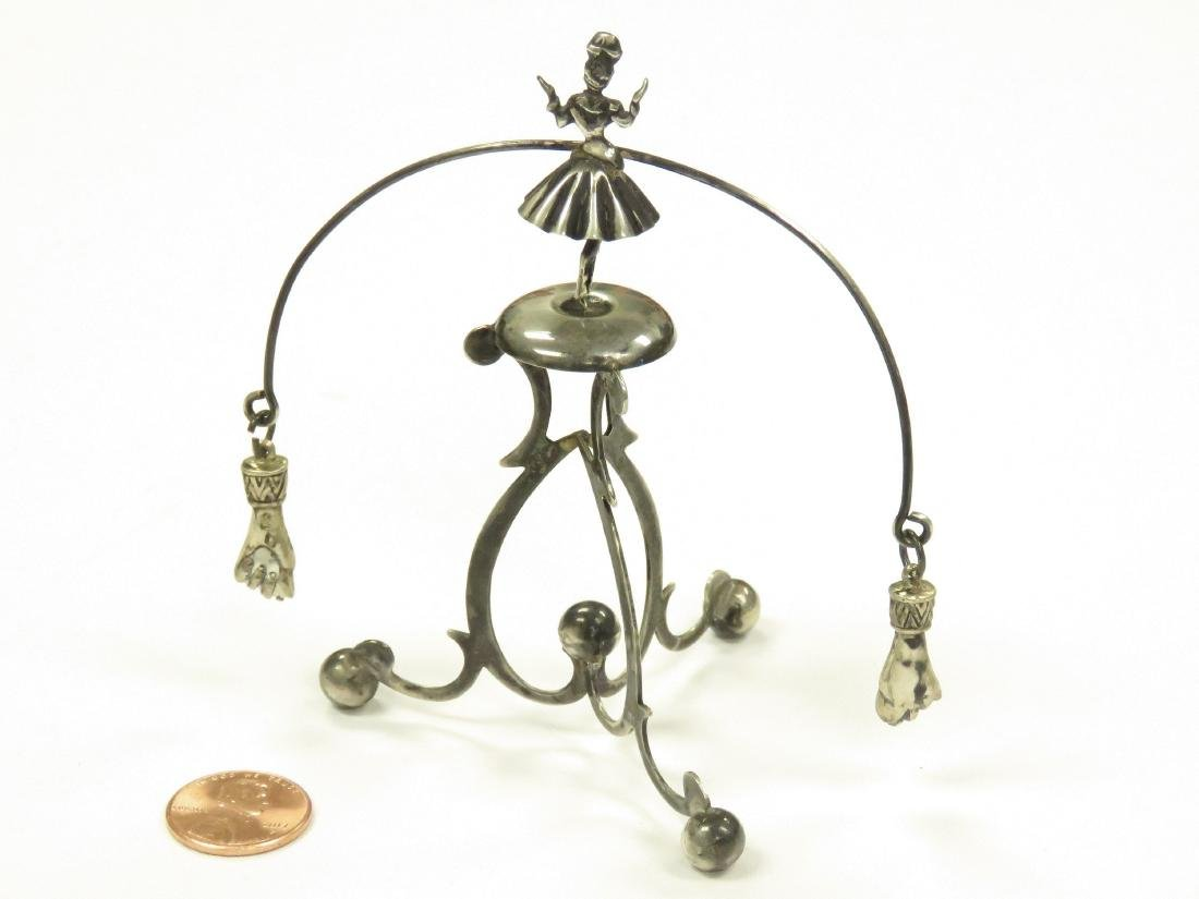 PORTUGUESE 833 SILVER FIGURAL BALANCING KINETIC