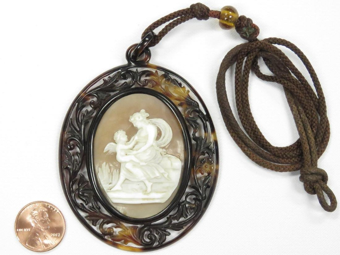 ANTIQUE CARVED SHELL CAMEO, CUPID AND VENUS WITH FRAMED