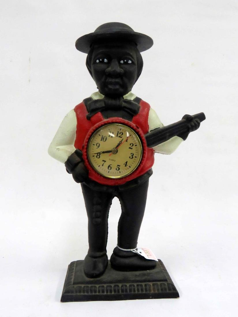 BLACK AMERICANA PAINTED AND CAST IRON MINSTREL CLOCK.