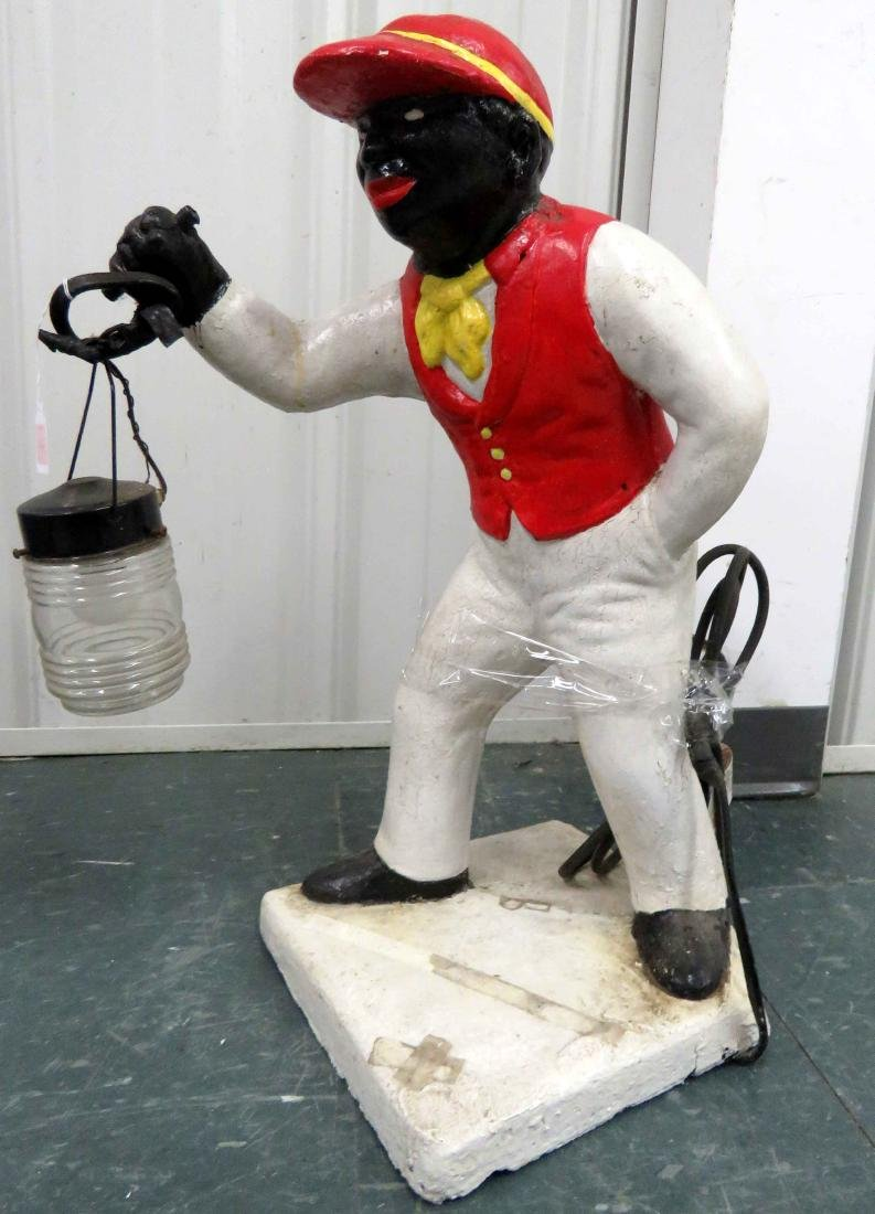 CAST STONE PAINTED LAWN JOCKEY. HEIGHT 27""