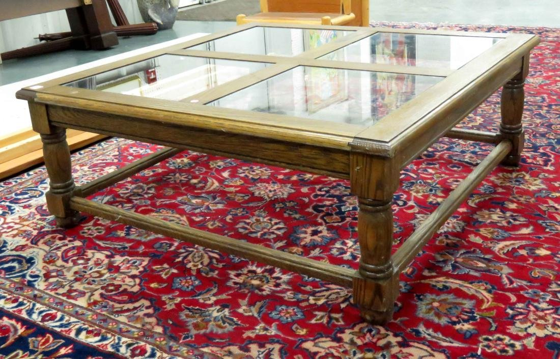 "OAK COFFEE TABLE WITH INSET GLASS PANELS. HEIGHT 15"";"