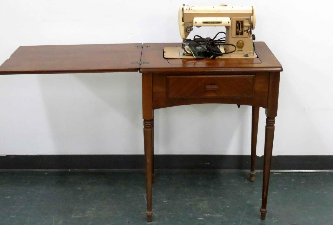SHERATON STYLE WALNUT SEWING MACHINE/CABINET